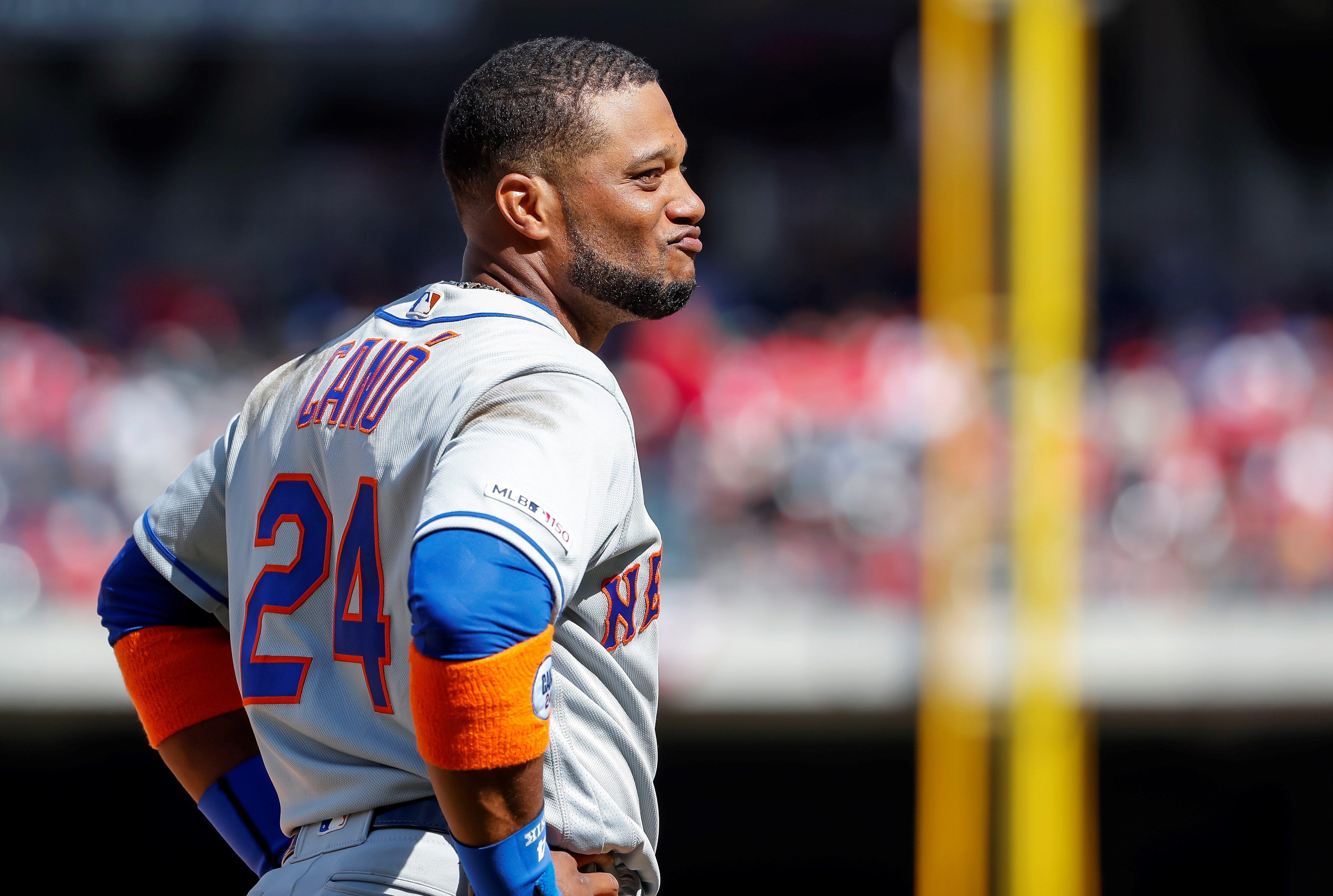 El segunda base de Mets Robinson Canó sonríe después de anotar una carrera este jueves. (Foto Prensa Libre: EFE)