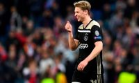 Ajax's Dutch midfielder Frenkie de Jong celebrates at the end of the UEFA Champions League round of 16 second leg football match between Real Madrid CF and Ajax at the Santiago Bernabeu stadium in Madrid on March 5, 2019. (Photo by GABRIEL BOUYS / AFP)