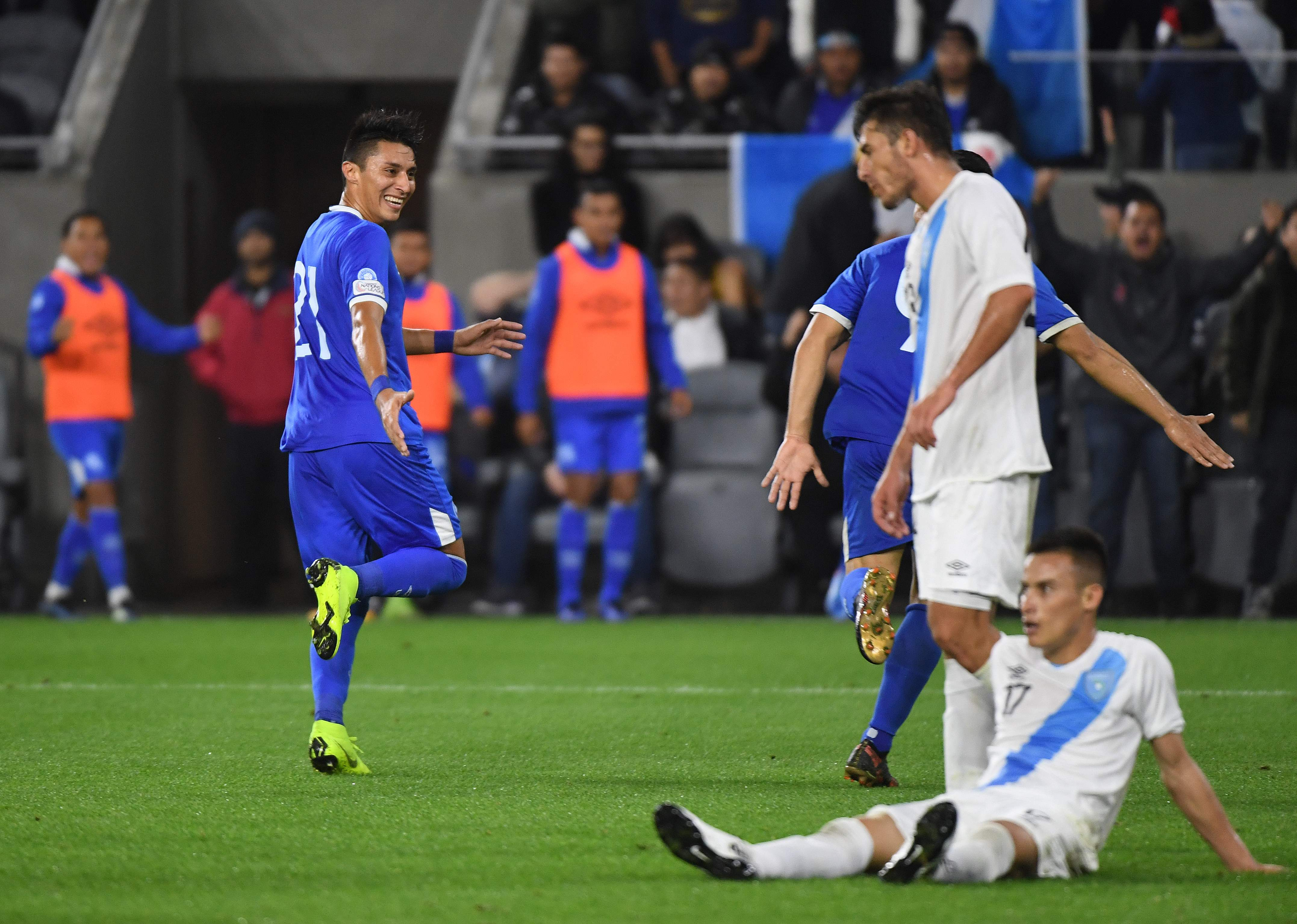 Bryan Tamacas of El Salvador (L) celebrates after scoring against Guatemala during their football friendly match at the Banc Of California Stadium in Los Angeles on March 6, 2019. - El Salvador won 3-1. (Photo by Mark RALSTON / AFP)