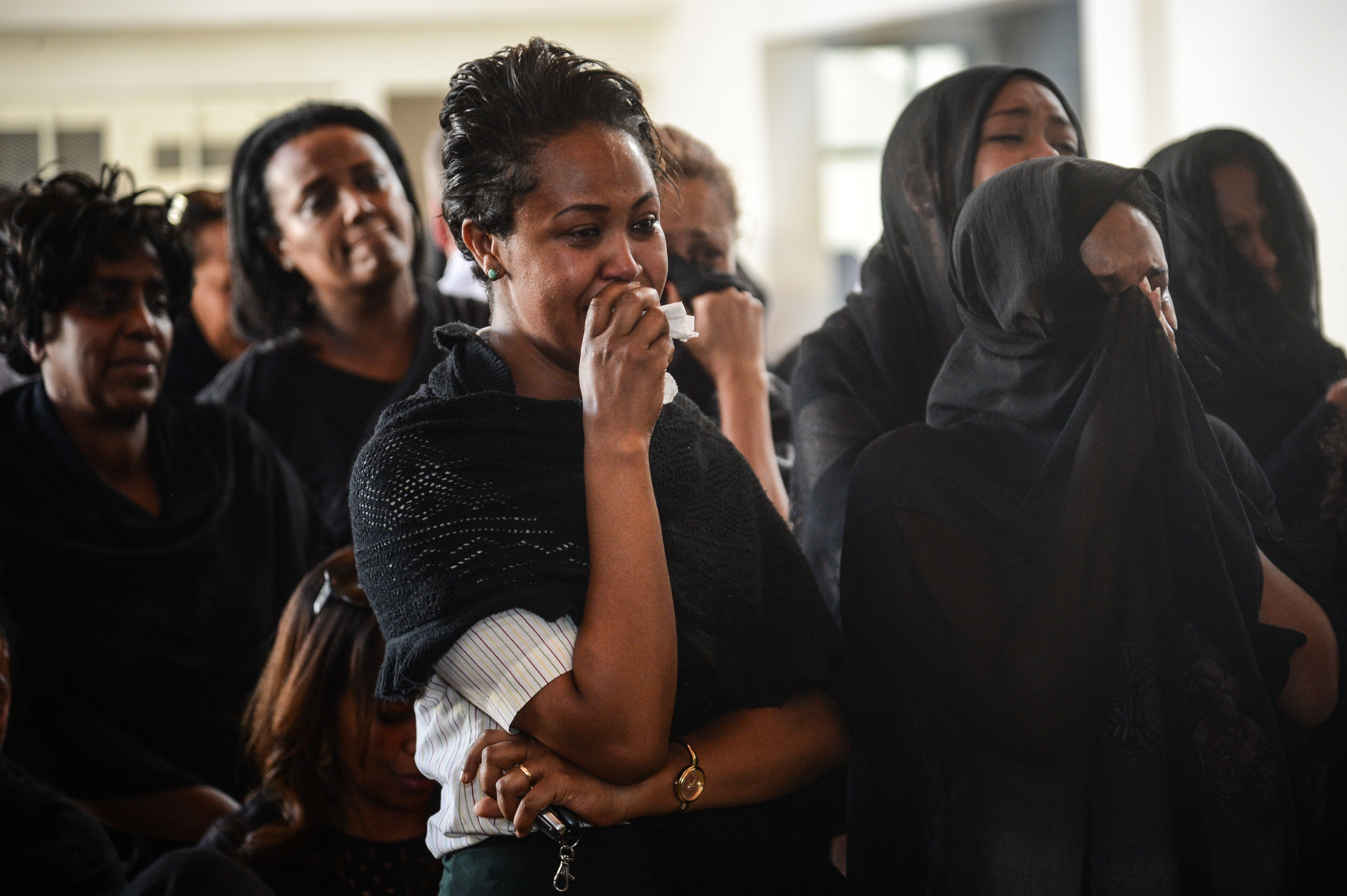 Women mourn during a memorial ceremony for the seven crew members who died in the Ethiopian Airlines accident at the Ethiopian Pilot Association Club in Addis Ababa, Ethiopia, on March 11, 2019. - Airlines in Ethiopia, China and Indonesia have grounded their Boeing 737 MAX 8 jets on March 11, as investigators recovered the black boxes from a brand-new passenger jet that crashed outside Addis Ababa a day earlier, killing all 157 people on board. (Photo by - / AFP)