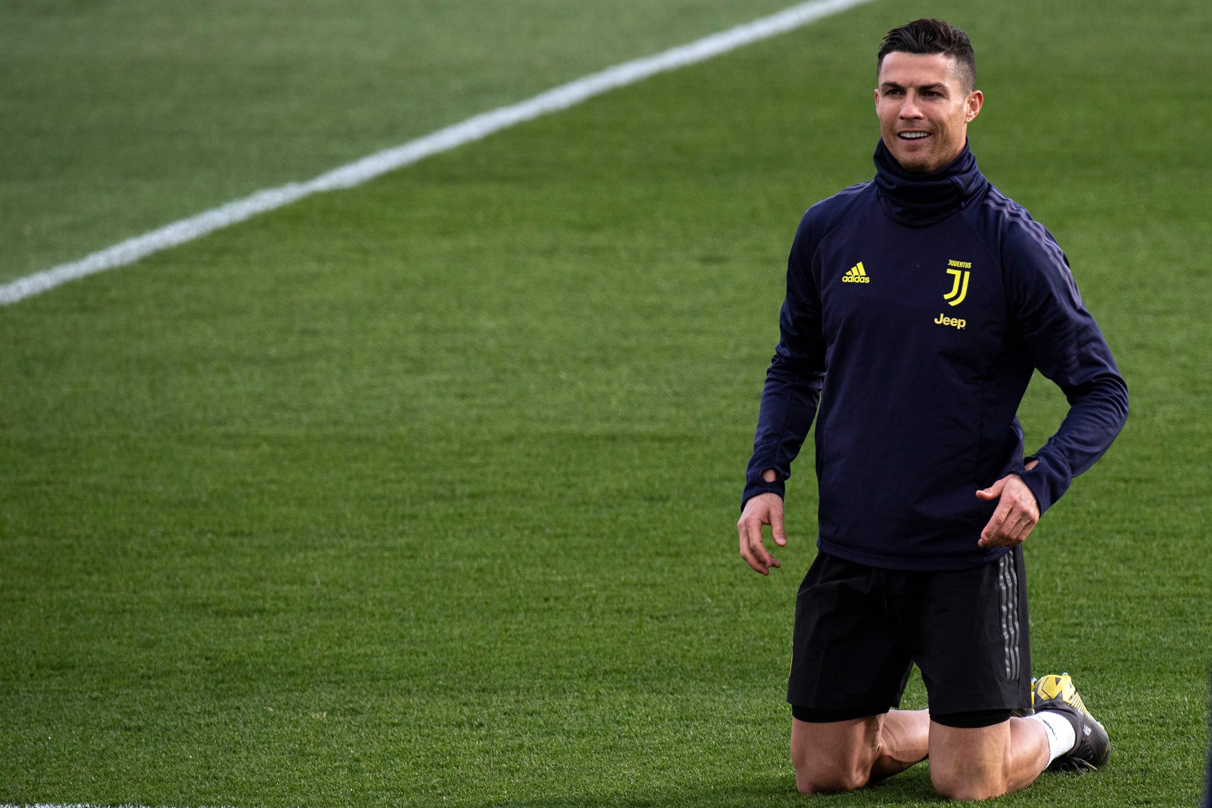 El delantero portugués Cristiano Ronaldo es feliz en Italia. (Foto Prensa Libre: AFP)
