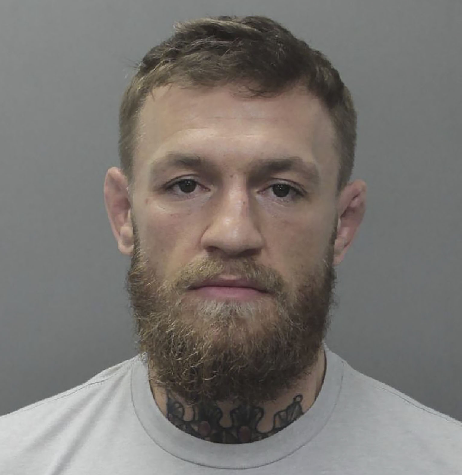 "This booking photo obtained on March 12, 2019 courtesy of the City of Miami Beach Police Department shows mixed martial arts fighter Conor McGregor. - Mixed martial arts fighter Conor McGregor was arrested March 11, 2019 by US police for allegedly smashing a fan's cell phone outside a Florida nightclub. The 30-year-old Irishman was charged with criminal mischief and strong-armed robbery after Miami police said he allegedly slapped the phone out of the fan's hand and then stomped on it. Miami Beach police said they were called to the scene outside the LIV Nightclub at 5:00 am (0900 GMT), The Miami Herald reported. The police started their investigation and McGregor was arrested later that day at a nearby home and then booked into the Miami-Dade jail. (Photo by HO / City of Miami Beach Police Department / AFP) / RESTRICTED TO EDITORIAL USE - MANDATORY CREDIT ""AFP PHOTO / CITY OF MIAMI BEACH POLICE DEPARTMENT/HANDOUT"" - NO MARKETING NO ADVERTISING CAMPAIGNS - DISTRIBUTED AS A SERVICE TO CLIENTS"