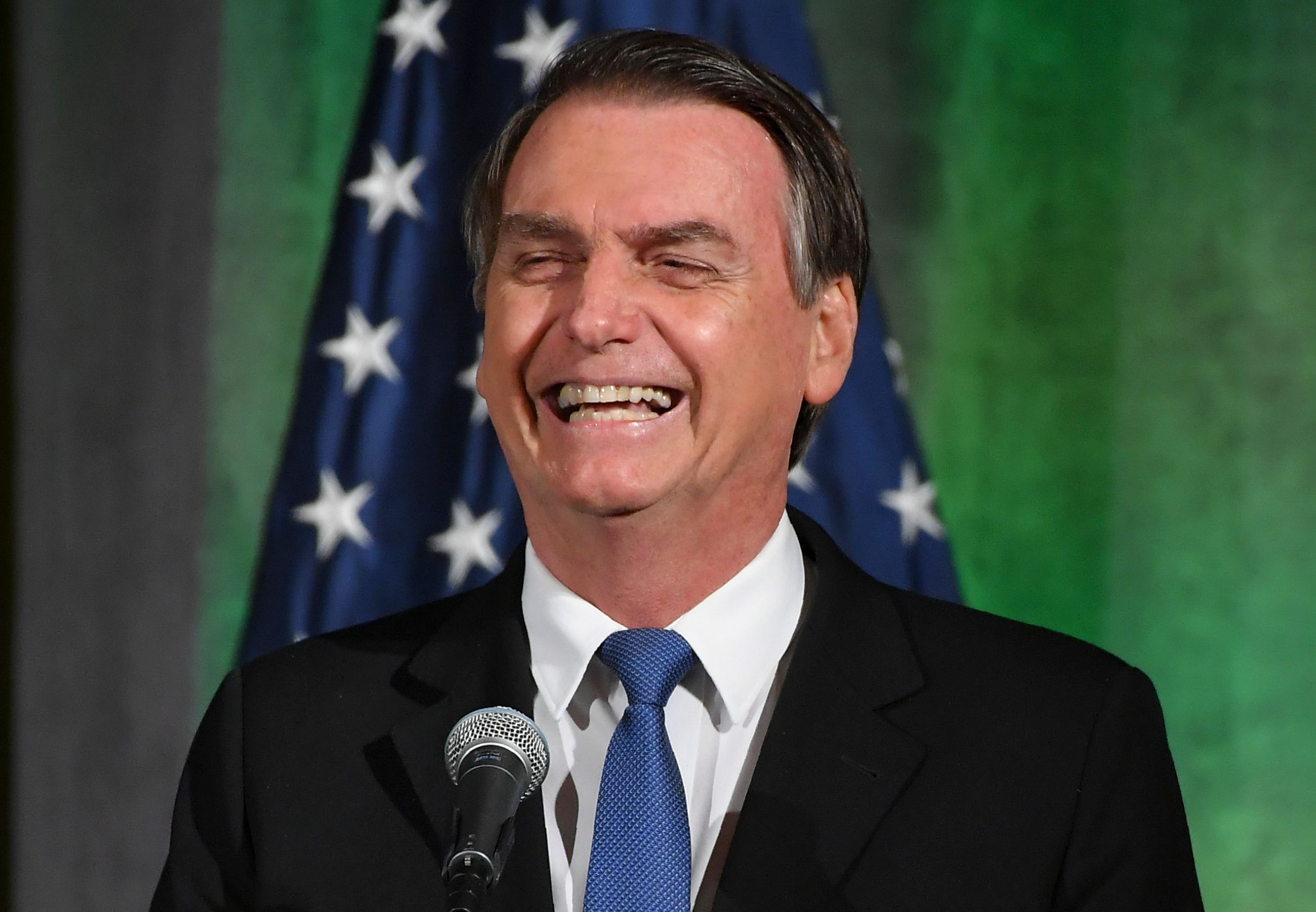 Brazil's President Jair Bolsonaro smiles during a discussion on US-Brazil relations at the US Chamber of Commerce in Washington, DC on March 18, 2019. (Photo by MANDEL NGAN / AFP)