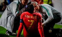 Doctors check on Portugal's forward Cristiano Ronaldo during the Euro 2020 qualifying group B football match between Portugal and Serbia at the Luz stadium in Lisbon on March 25, 2019. (Photo by PATRICIA DE MELO MOREIRA / AFP)