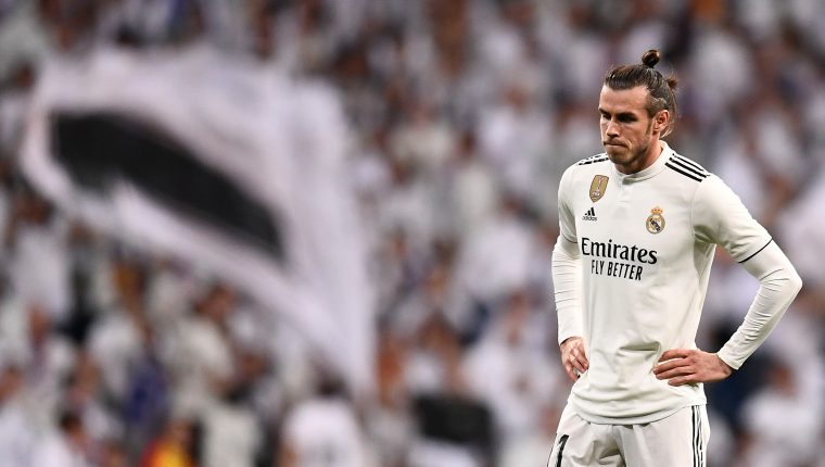 Real Madrid's Welsh forward Gareth Bale stands on the field during the Spanish league football match between Real Madrid CF and FC Barcelona at the Santiago Bernabeu stadium in Madrid on March 2, 2019. (Photo by OSCAR DEL POZO / AFP)