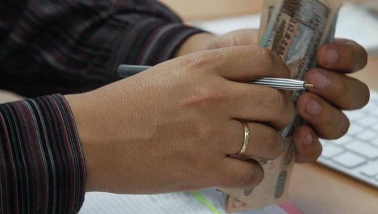 Se estima que unos Q165 millones es el monto detectado de lavado de dinero en lo que va del año por la IVE. (Foto Prensa Libre: Hemeroteca)