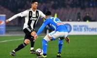 Juventus' Portuguese forward Cristiano Ronaldo (L) fights for the ball with Napoli's Albanian defender Elseid Hysaj during the Italian Serie A football match between Napoli and Juventus on March 3, 2019, at the San Paolo Stadium in Naples. (Photo by Alberto PIZZOLI / AFP)