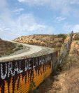 El presidente Donald Trump insiste en la construcción de un muro fronterizo para contener la migración. (Foto: AFP)