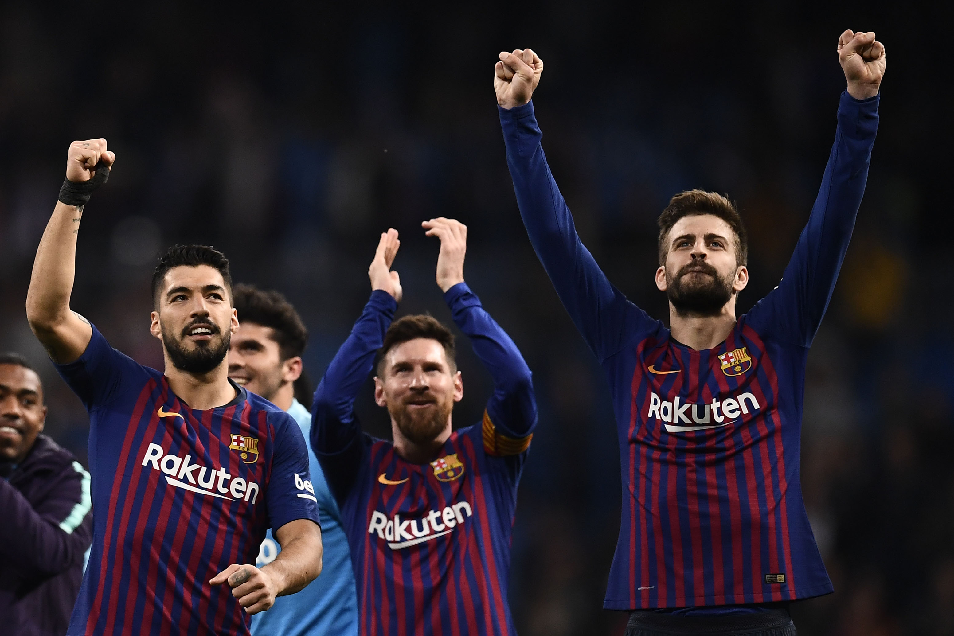 Barcelona's Uruguayan forward Luis Suarez (L), Barcelona's Argentinian forward Lionel Messi (C) and Barcelona's Spanish defender Gerard Pique celebrate their win at the end of the Spanish league football match between Real Madrid CF and FC Barcelona at the Santiago Bernabeu stadium in Madrid on March 2, 2019. (Photo by OSCAR DEL POZO / AFP)