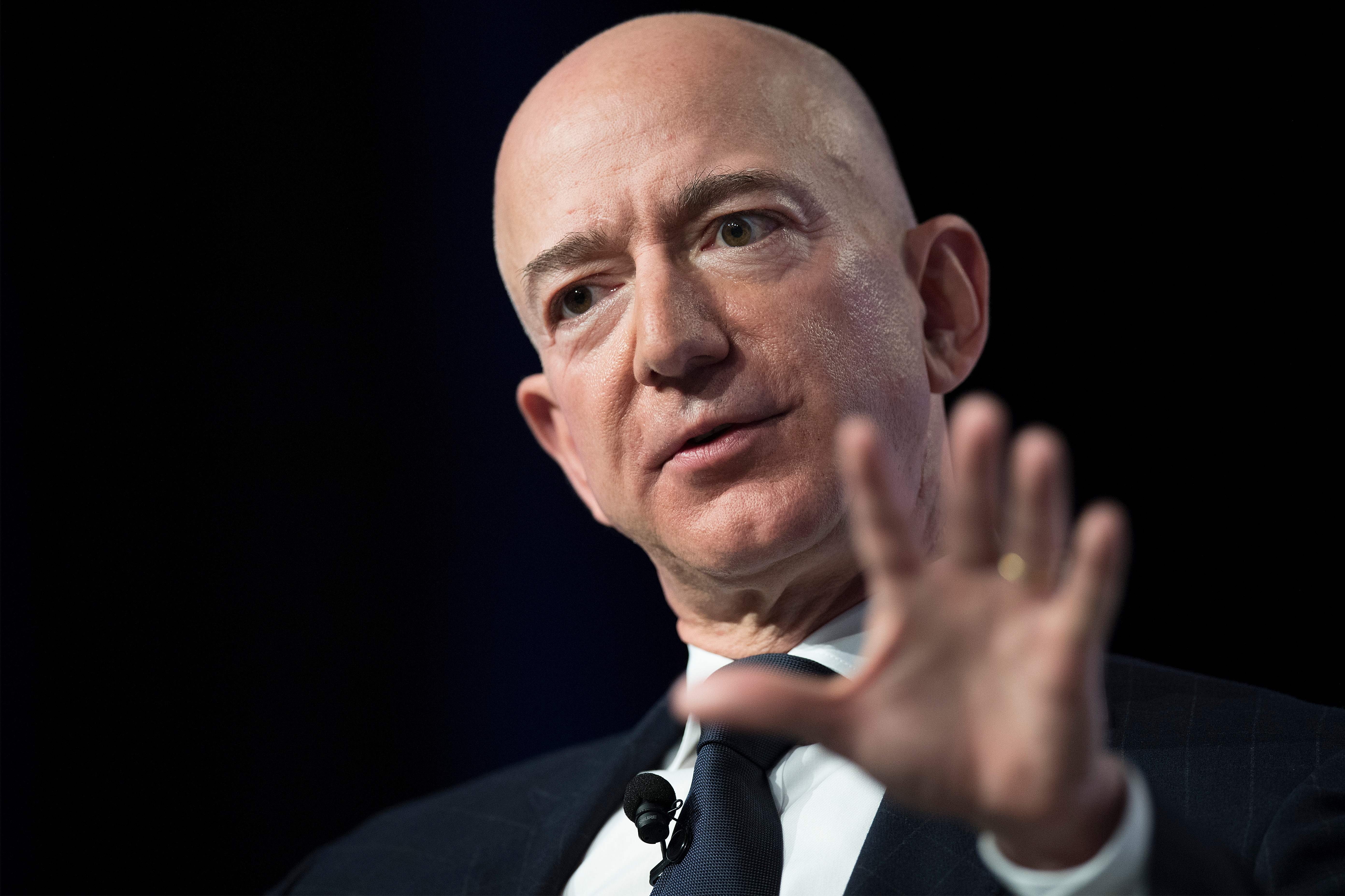 (FILES) In this file photo taken on September 19, 2018 Amazon and Blue Origin founder Jeff Bezos provides the keynote address at the Air Force Association's Annual Air, Space & Cyber Conference in Oxen Hill, Maryland. - Jeff Bezos remains the world's richest person, ahead of Bill Gates and Warren Buffett, according to the latest Forbes list of the ultra wealthy. But while things are largely stable up top in that ranking, Facebook founder Mark Zuckerberg dropped three spots and former New York mayor Michael Bloomberg rose by two. According to the list announced March 4, 2019 by Forbes, the riches of Bezos, 55, have swelled by $19 billion in one year and he is now worth $131 billion. (Photo by Jim WATSON / AFP)
