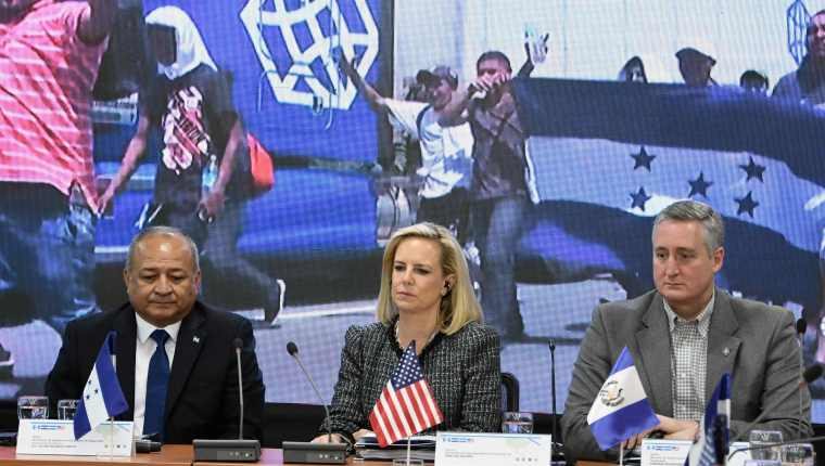US Secretary of Homeland Security Kirstjen Nielsen (C), Honduran Security Minister Julian Pacheco (L) and Guatemalan Minister of Government Enrique Degenhart (R) attend the V Meeting of Ministers and Secretaries of Security of the Northern Trialgle and the US in Tegucigalpa on March 27, 2019. - The meeting is to discuss migration and insecirity in Central America. (Photo by ORLANDO SIERRA / AFP)