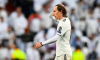 Real Madrid's Croatian midfielder Luka Modric reacts as he walks off the pitch at half-time during the UEFA Champions League round of 16 second leg football match between Real Madrid CF and Ajax at the Santiago Bernabeu stadium in Madrid on March 5, 2019. (Photo by GABRIEL BOUYS / AFP)