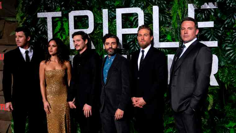 "Cast members (from L) Garrett Hedlund, Adria Arjona,Pedro Pascal, Oscar Isaac, Charlie Hunnam and Ben Affleck arrive for the world premiere of ""Triple Frontier"" on March 3, 2019 in New York City. - The movie will be released in theatres on March 6. (Photo by Johannes EISELE / AFP)"