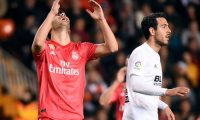 Real Madrid's Spanish midfielder Marco Asensio (L) gestures during the Spanish league football match between Valencia CF and Real Madrid CF at the Mestalla stadium in Valencia on April 3, 2019. (Photo by JOSE JORDAN / AFP)