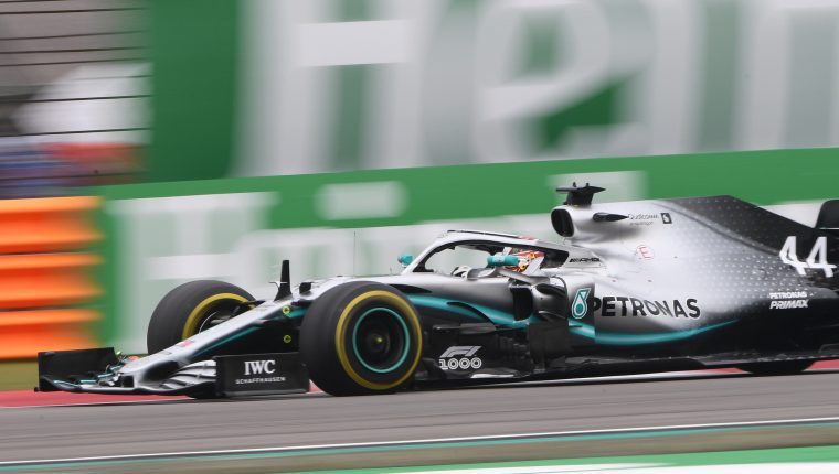 """Mercedes' British driver Lewis Hamilton takes a corner during the Formula One Chinese Grand Prix in Shanghai on April 14, 2019. (Photo by Greg Baker / AFP) / """"The erroneous mention[s] appearing in the metadata of this photo by HU CHENGWEI has been modified in AFP systems in the following manner: [byline as Greg BAKER/STF] instead of [HU Chengwei/POOL]. Please immediately remove the erroneous mention[s] from all your online services and delete it (them) from your servers. If you have been authorized by AFP to distribute it (them) to third parties, please ensure that the same actions are carried out by them. Failure to promptly comply with these instructions will entail liability on your part for any continued or post notification usage. Therefore we thank you very much for all your attention and prompt action. We are sorry for the inconvenience this notification may cause and remain at your disposal for any further information you may require."""""""