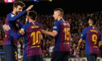 Barcelona's Argentinian forward Lionel Messi (2L) celebrates his goal with Barcelona's Spanish defender Gerard Pique (L) during the Spanish League football match between FC Barcelona and Levante UD at the Camp Nou stadium in Barcelona on April 27, 2019. (Photo by PAU BARRENA / AFP)