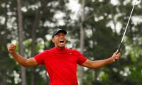AUGUSTA, GEORGIA - APRIL 14: Tiger Woods of the United States celebrates after sinking his putt on the 18th green to win during the final round of the Masters at Augusta National Golf Club on April 14, 2019 in Augusta, Georgia.   Kevin C. Cox/Getty Images/AFP == FOR NEWSPAPERS, INTERNET, TELCOS & TELEVISION USE ONLY ==