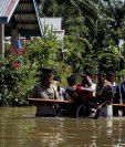 Varios lugares fueron inundados y los pobladores debieron abandonar sus viviendas. (Foto Prensa Libre: EFE)