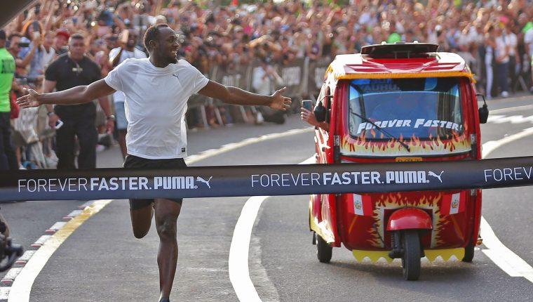 El jamaicano Usain Bolt llevó alegría a Perú y demostró su condición física. (Foto Prensa Libre: AFP)