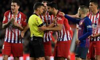 Atletico Madrid's Spanish forward Diego Costa (C R) talks with Spanish referee Gil Manzano prior to receiving a red card during the Spanish league football match between FC Barcelona and Club Atletico de Madrid at the Camp Nou stadium in Barcelona on April 6, 2019. (Photo by LLUIS GENE / AFP)