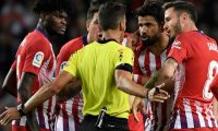 Atletico Madrid's Spanish forward Diego Costa (2R) talks with Spanish referee Gil Manzano prior to receiving a red card during the Spanish league football match between FC Barcelona and Club Atletico de Madrid at the Camp Nou stadium in Barcelona on April 6, 2019. (Photo by LLUIS GENE / AFP)