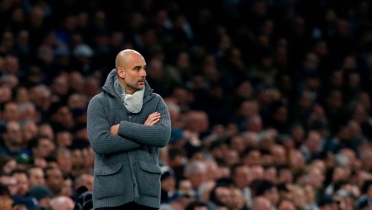 Manchester City's Spanish manager Pep Guardiola reacts during the UEFA Champions League quarter-final first leg football match between Tottenham Hotspur and Manchester City at the Tottenham Hotspur Stadium in north London, on April 9, 2019. (Photo by Ian KINGTON / IKIMAGES / AFP)