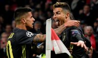 Juventus' Portuguese forward Cristiano Ronaldo (R) celebrates with teammates after scoring a goal  during the UEFA Champions League first leg quarter-final football match between Ajax Amsterdam and Juventus FC at the Johan Cruijff ArenA in Amsterdam on April 10, 2019. (Photo by JOHN THYS / AFP)