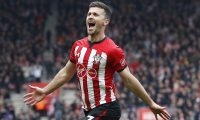 Southampton's Irish striker Shane Long celebrates after scoring their third goal during the English Premier League football match between Southampton and Wolverhampton Wanderers at St Mary's Stadium in Southampton, southern England on April 13, 2019. (Photo by Adrian DENNIS / AFP) / RESTRICTED TO EDITORIAL USE. No use with unauthorized audio, video, data, fixture lists, club/league logos or 'live' services. Online in-match use limited to 120 images. An additional 40 images may be used in extra time. No video emulation. Social media in-match use limited to 120 images. An additional 40 images may be used in extra time. No use in betting publications, games or single club/league/player publications. /