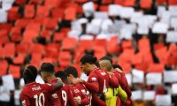 Liverpool players observe a minute's silence for the 30th Anniversary of the the Hillsborough football stadium disaster where 96 men, women and children died in a fatal crush at an FA Cup tie between Liverpool and Nottingham Forest at Hillsborough, ahead of the English Premier League football match between Liverpool and Chelsea at Anfield in Liverpool, north west England on April 14, 2019. (Photo by Paul ELLIS / AFP) / RESTRICTED TO EDITORIAL USE. No use with unauthorized audio, video, data, fixture lists, club/league logos or 'live' services. Online in-match use limited to 120 images. An additional 40 images may be used in extra time. No video emulation. Social media in-match use limited to 120 images. An additional 40 images may be used in extra time. No use in betting publications, games or single club/league/player publications. /