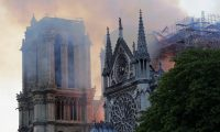 Smoke rises during a fire at the landmark Notre-Dame Cathedral in central Paris on April 15, 2019. - A fire broke out at the landmark Notre-Dame Cathedral in central Paris, potentially involving renovation works being carried out at the site, the fire service said. (Photo by Thomas SAMSON / AFP)