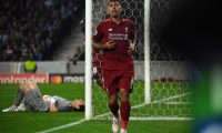 Liverpool's Brazilian midfielder Roberto Firmino celebrates after scoring his team's third goal during the UEFA Champions League quarter-final second leg football match between FC Porto and Liverpool at the Dragao Stadium in Porto on April 17, 2019. (Photo by Paul ELLIS / AFP)