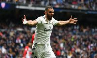 Real Madrid's French forward Karim Benzema celebrates his second goal during the Spanish League football match between Real Madrid and Athletic Bilbao at the Santiago Bernabeu Stadium in Madrid on April 21, 2019. (Photo by GABRIEL BOUYS / AFP)
