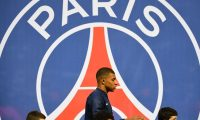 Paris Saint-Germain's French forward Kylian Mbappe and children walk in front of a Paris Saint-Germain's logo prior to the French L1 football match between Paris Saint-Germain (PSG) and Monaco (ASM) on April 21, 2019 at the Parc des Princes stadium in Paris. (Photo by FRANCK FIFE / AFP)