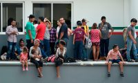 "Central American migrants wait to be deported by members of the Mexican National Migration Institute (INM on spanish) inside a detention center in Tapachula, Chiapas, Mexico on April 26, 2019. - At least 1,300 mainly Cuban migrants escaped Thursday from a detention center in southern Mexico after threatening to set fire to the facility to protest against overcrowding.Since October, tens thousands of Central Americans and Cubans have traversed Mexico in so-called ""caravans"" in the hope of obtaining sanctuary in the United States. (Photo by ALFREDO ESTRELLA / AFP)"