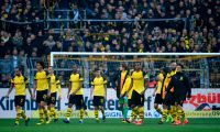 Dortmund's team players leave the field after they lost the German First division Bundesliga football match BVB Borussia Dortmund v Schalke 04 in Dortmund, western Germany on April 27, 2019. (Photo by INA FASSBENDER / AFP) / DFL REGULATIONS PROHIBIT ANY USE OF PHOTOGRAPHS AS IMAGE SEQUENCES AND/OR QUASI-VIDEO