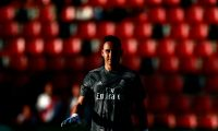 Real Madrid's Costa Rican goalkeeper Keylor Navas walks on the pitch before the Spanish League football match between Rayo Vallecano and Real Madrid at the Vallecas Stadium in the Madrid district of Puente de Vallecas on April 28, 2019. (Photo by Benjamin CREMEL / AFP)