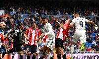 Real Madrid's French forward Karim Benzema (R) scores a header past Athletic Bilbao's Spanish goalkeeper Iago Herrerin (L) during the Spanish League football match between Real Madrid and Athletic Bilbao at the Santiago Bernabeu Stadium in Madrid on April 21, 2019. (Photo by GABRIEL BOUYS / AFP)