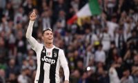 """Juventus' Portuguese forward Cristiano Ronaldo acknowledges fans and celebrates after Juventus secured its 8th consecutive Italian 2018/19 """"Scudetto"""" Serie A championships, after winning the Italian Serie A football match Juventus vs Fiorentina on April 20, 2019 at the Juventus stadium in Turin. (Photo by Marco Bertorello / AFP)"""