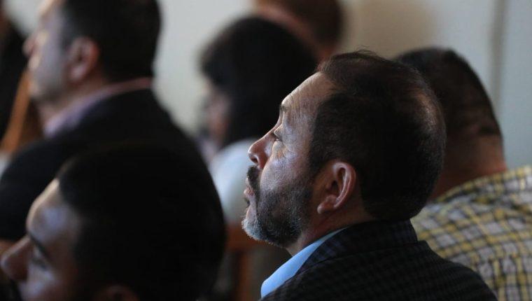 El exministro de Gobernación, Mauricio López Bonilla, escuchó la petición de la representante del MP durante las conclusiones del debate. (Foto Prensa Libre: Carlos Hernández)