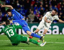 El Real Madrid no pudo romper el muro defensivo de Getafe y se conformó con un empate. (Foto Prensa Libre: AFP)