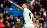 Real Madrid's French forward Karim Benzema celebrates after scoring during the Spanish league football match between Real Madrid CF and SD Eibar at the Santiago Bernabeu stadium in Madrid on April 6, 2019. (Photo by GABRIEL BOUYS / AFP)