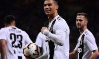 Juventus' Portuguese forward Cristiano Ronaldo (C) celebrates after scoring a goal during the Italian Serie A football match between Inter Milan and Juventus on April 27, 2019 at the San Siro stadium in Milan. (Photo by MARCO BERTORELLO / AFP)