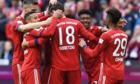 Bayern Munich's midfielder Leon Goretzka (2ndR) is congratulated by teammates Niklas Suele, Thiago Alcantara, Jerome Boateng, David Alaba and Kingsley Coman after he scored the team's second goal during the German first division Bundesliga football match FC Bayern Munich v Hanover 96  in Munich, southern Germany on May 4, 2019. (Photo by Christof STACHE / AFP) / DFL REGULATIONS PROHIBIT ANY USE OF PHOTOGRAPHS AS IMAGE SEQUENCES AND/OR QUASI-VIDEO