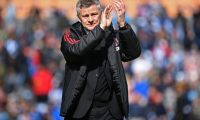 Manchester United's Norwegian manager Ole Gunnar Solskjaer applauds supporters after the English Premier League football match between Huddersfield Town and Manchester United at the John Smith's stadium in Huddersfield, northern England on May 5, 2019. - Manchester United fail to qualify for the Champions League after 1-1 draw at Huddersfield. (Photo by Paul ELLIS / AFP) / RESTRICTED TO EDITORIAL USE. No use with unauthorized audio, video, data, fixture lists, club/league logos or 'live' services. Online in-match use limited to 120 images. An additional 40 images may be used in extra time. No video emulation. Social media in-match use limited to 120 images. An additional 40 images may be used in extra time. No use in betting publications, games or single club/league/player publications. /