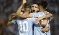 Celta Vigo's Spanish forward Iago Aspas (L) celebrates his goal with teammates Uruguayan forward Maxi Gomez (C) and Spanish midfielder Brais Mendez during the Spanish league football match between RC Celta de Vigo and FC Barcelona at the Balaidos stadium in Vigo on May 4, 2019. (Photo by MIGUEL RIOPA / AFP)
