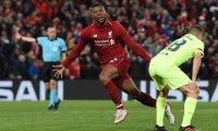 Liverpool's Dutch midfielder Georginio Wijnaldum celebrates after scoring their third goal during the UEFA Champions league semi-final second leg football match between Liverpool and Barcelona at Anfield in Liverpool, north west England on May 7, 2019. (Photo by Paul ELLIS / AFP)