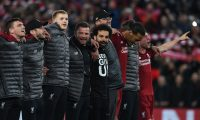 Liverpool players including Liverpool's German manager Jurgen Klopp celebrate after winning the UEFA Champions league semi-final second leg football match between Liverpool and Barcelona at Anfield in Liverpool, north west England on May 7, 2019. (Photo by Paul ELLIS / AFP)