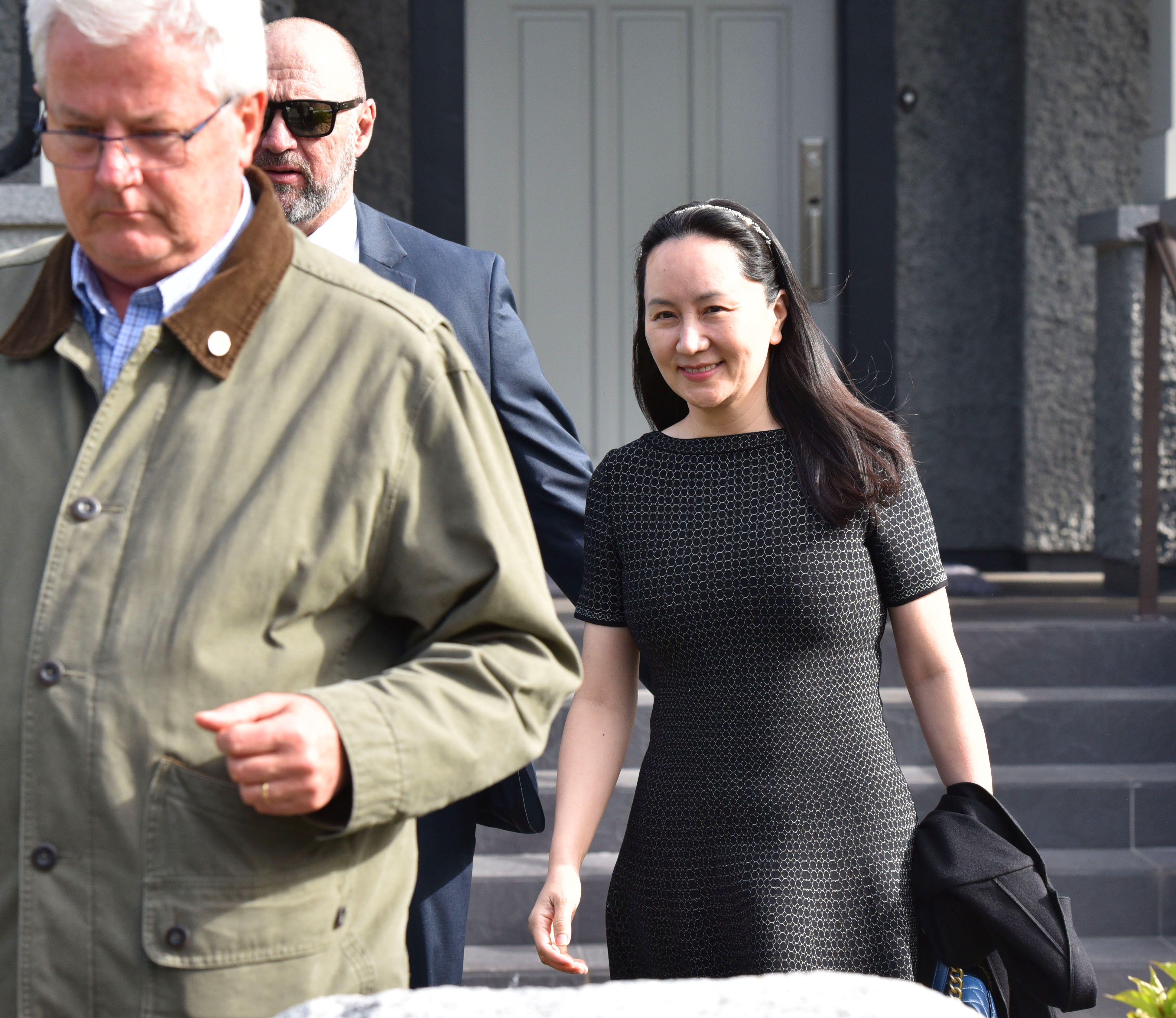 Huawei Chief Financial Officer, Meng Wanzhou, leaves her residence to attend British Columbia Supreme Court, in Vancouver, on March 8, 2019. - Meng, whose Vancouver arrest on a US warrant triggered a diplomatic row between Ottawa and Beijing, was to appear in court to fight for her release. Canada's justice department said the court will set the next key dates in an extradition process -- including the start of the formal hearing for Meng , which could take months or even years. (Photo by Don MacKinnon / AFP)