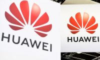 Logos of the Chinese telecome group Huawei is diplayed during the Vivatech startups and innovation fair, in Paris on May 16, 2019. (Photo by ALAIN JOCARD / AFP)