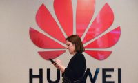 People attend a speech by Huawei Chief Representative to the European Institutions Abraham Liu at Huawei Cybersecurity Center on May 21, 2019 in Brussels. - Washington last week imposed a ban on the sale or transfer of American technology to the firm which could impact hundreds of millions of Huawei phones and tablets around the world. (Photo by EMMANUEL DUNAND / AFP)